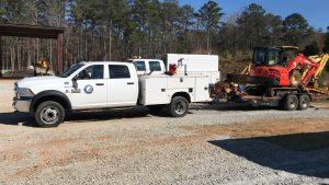 service truck and mini excavator